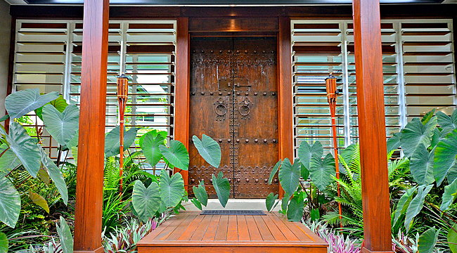 Balinese Style Front Door with louvres and green gardens either side