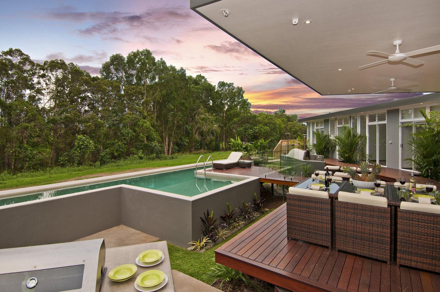 Outdoor dining area overlooking free standing pool
