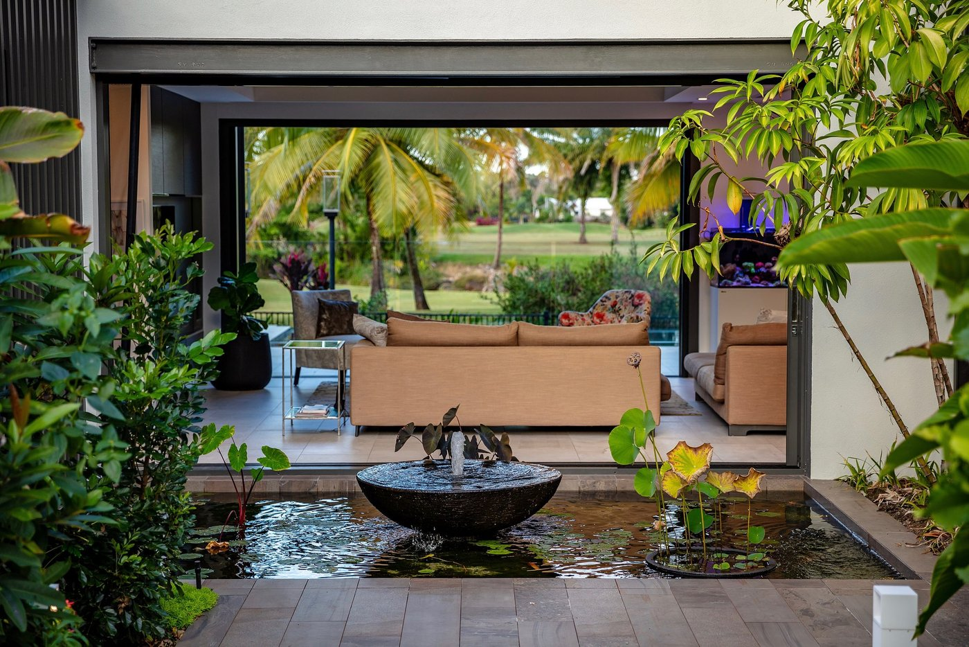 Water feature with lounge room in the background