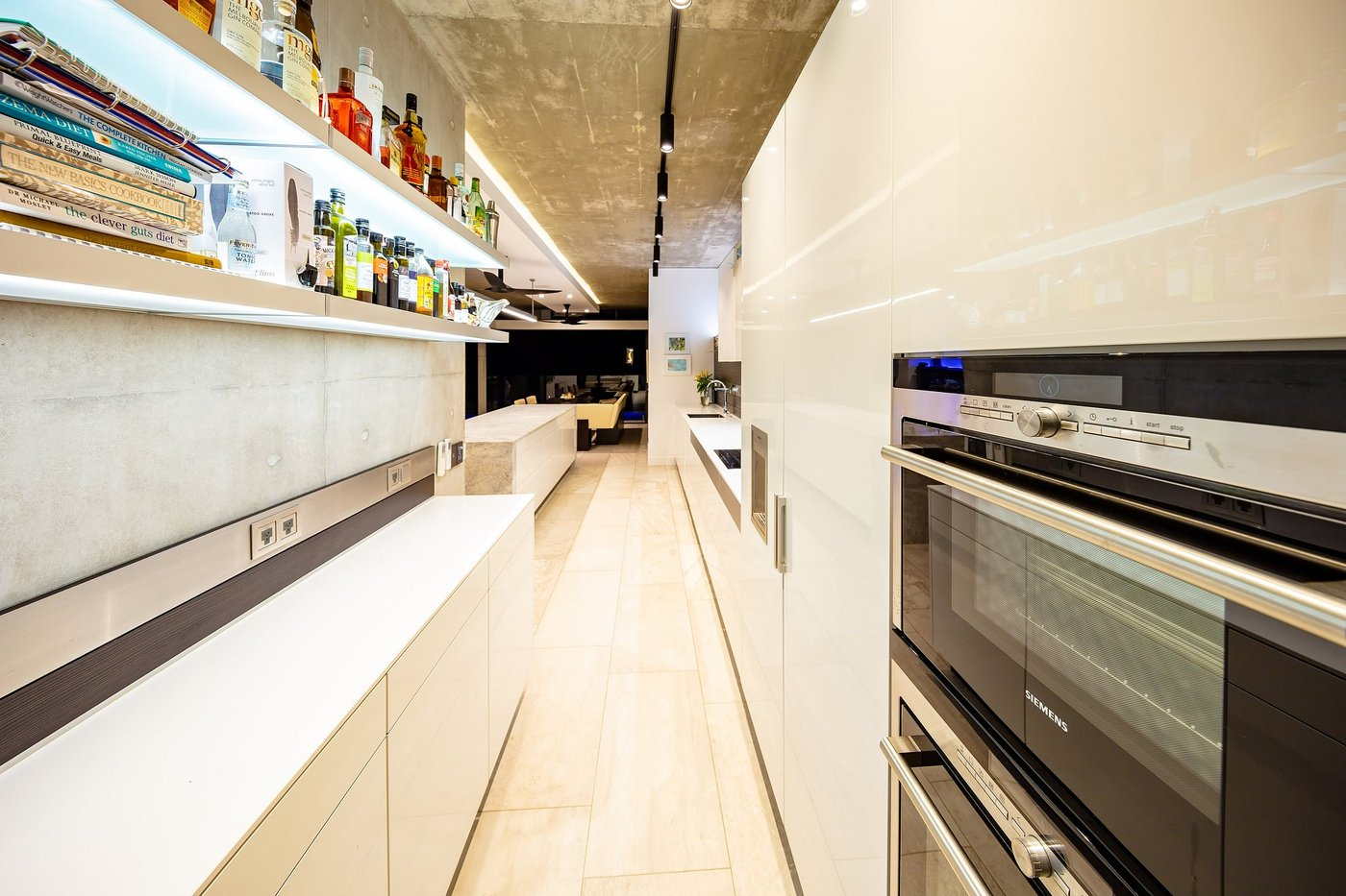 White Euro Kitchen with wall mounted oven