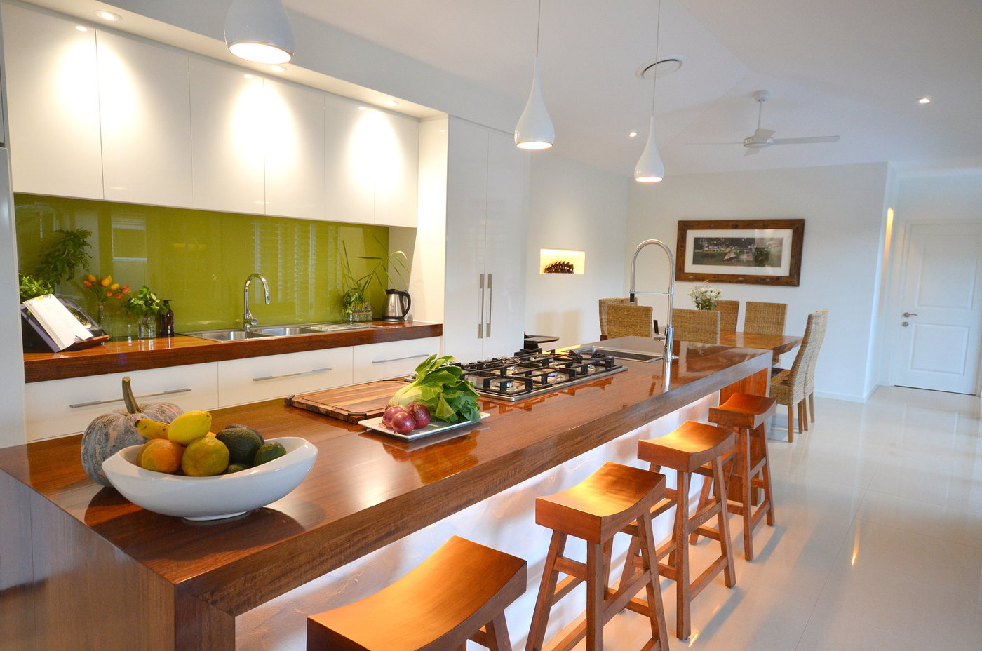 New kitchen design with island bench and wooden stools