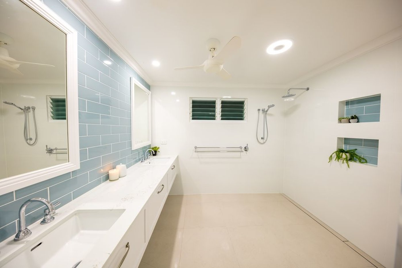 Complete renovation to bathroom white with green subway tiles and niches