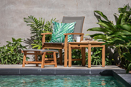 Chair and table next to pool