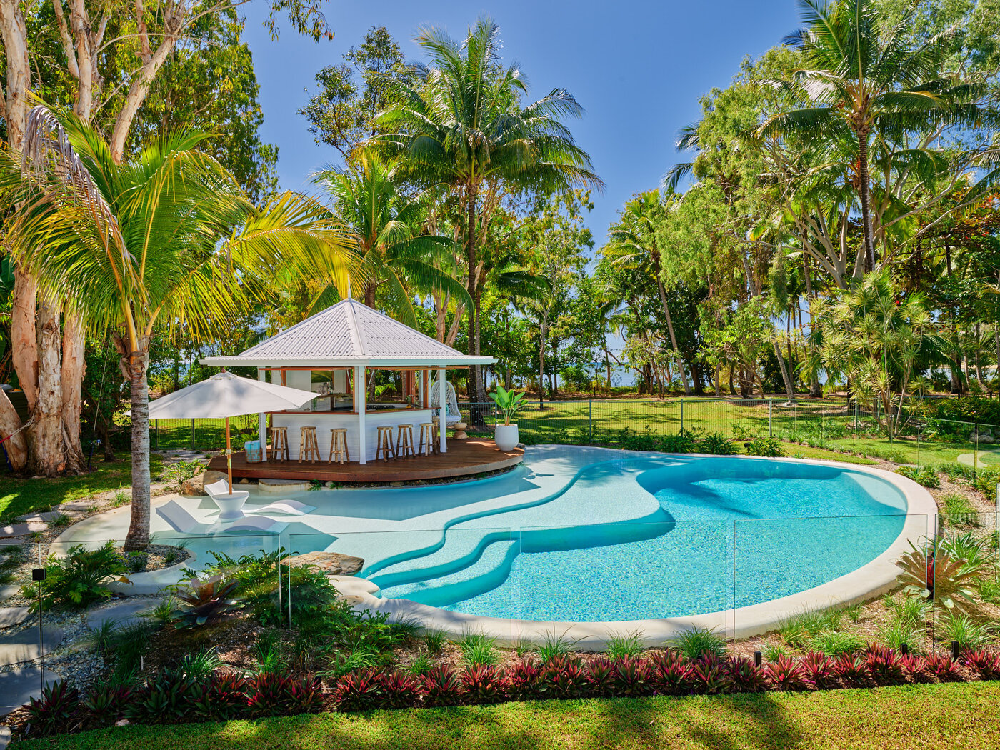 Custom Designed Resort Style Pool with Umbrella, pool chairs and palm trees