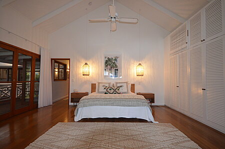 White Bedroom with Cathedral Ceiling
