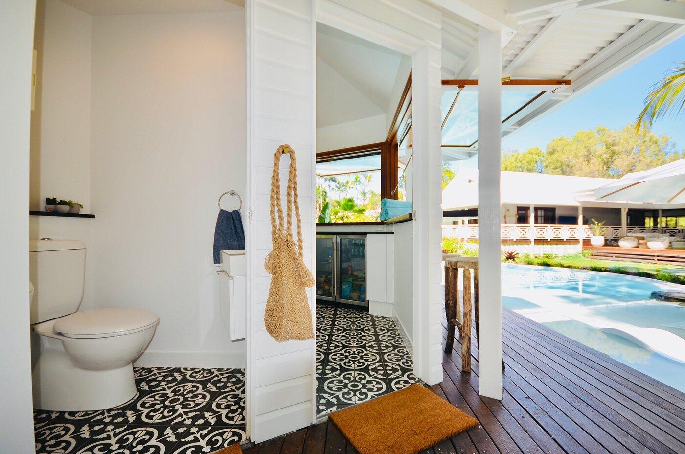 Custom designed pool cabana complete with kitchen & bathroom