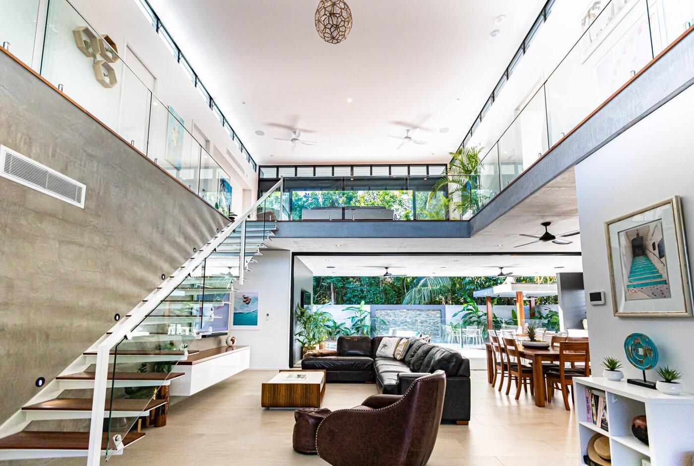 Large atrium showcases the elaborate seven-metre height, off-form concrete ceilings & open plan living spaces