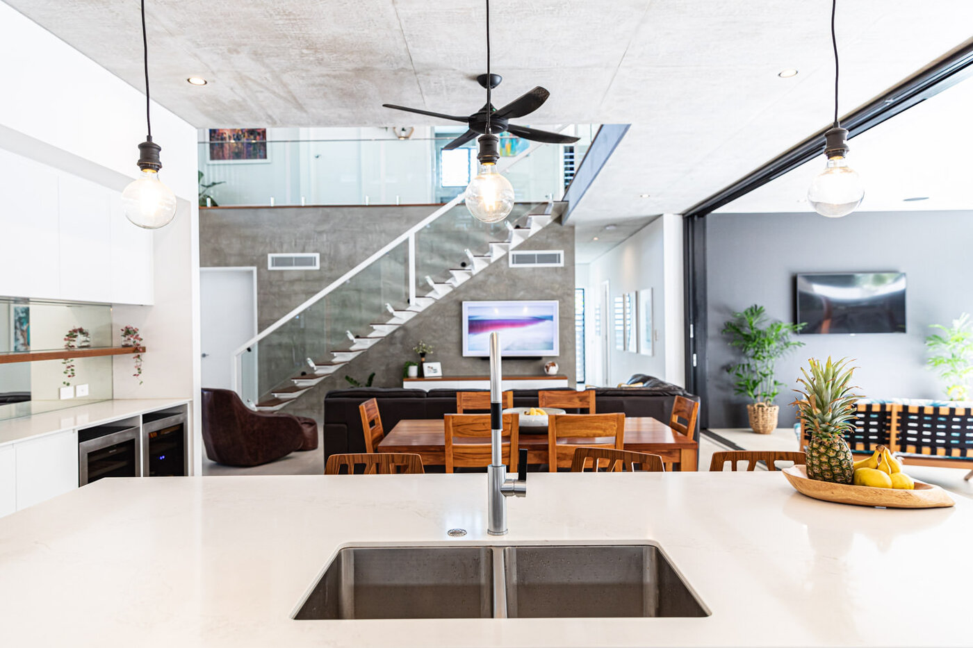 Luxurious dining area with wine fridge overlooking living room