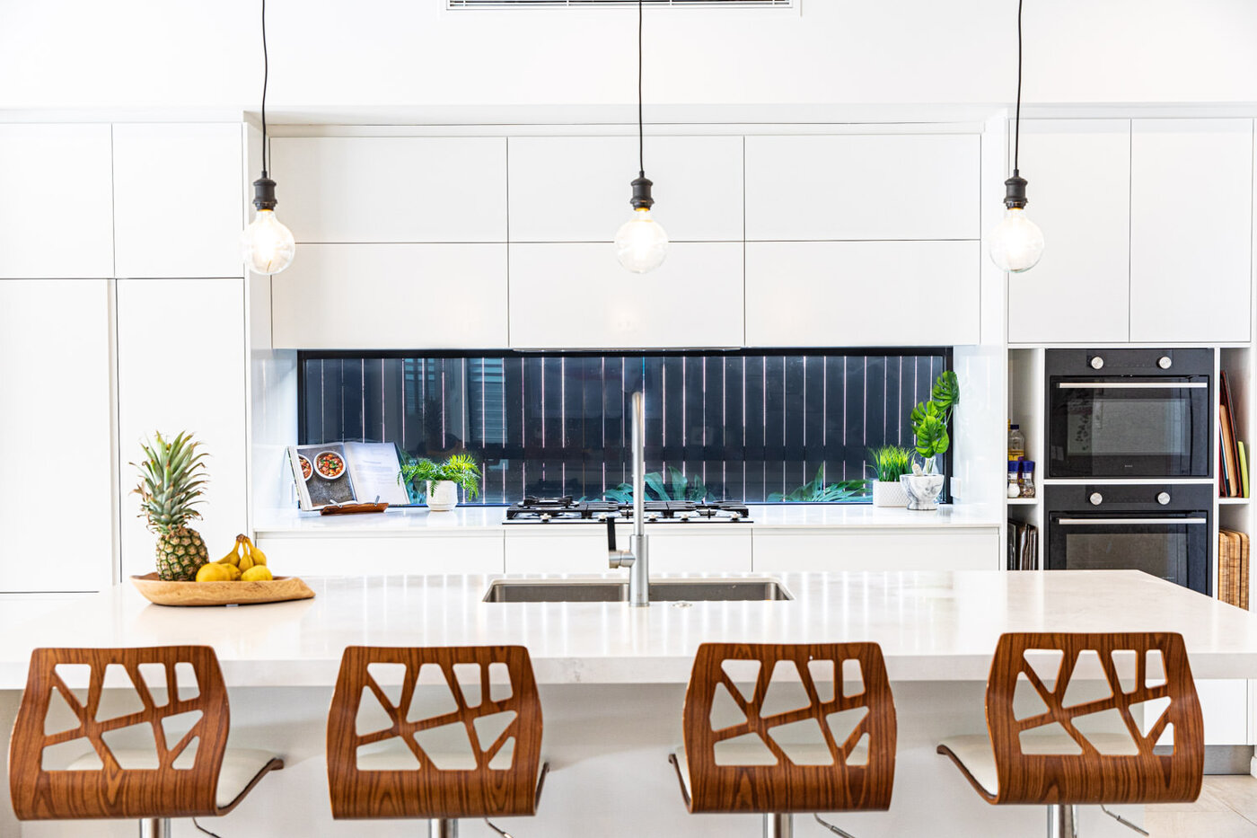 Luxury kitchen with bar stools and pendants at an island bench